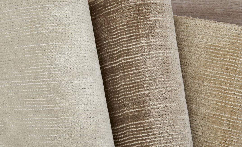 large rolls of tan carpets