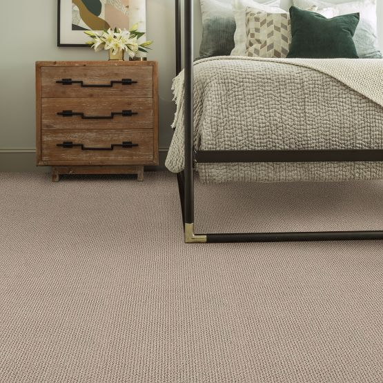 bedroom with tan carpet