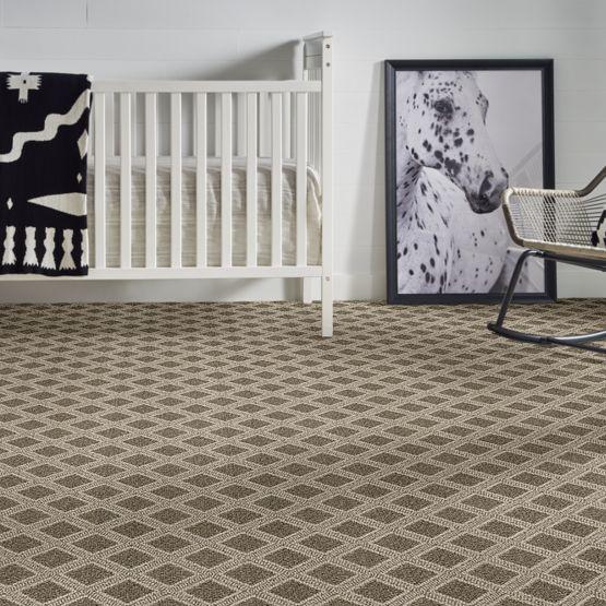 pattern dark tan carpet in baby's room