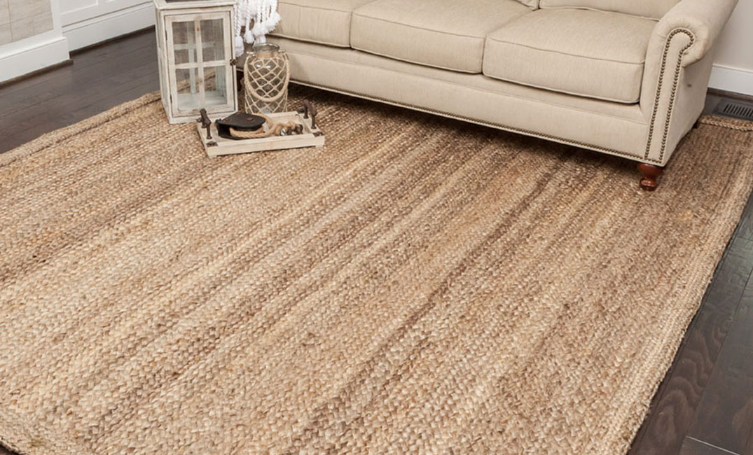 tan jute area rug in living room