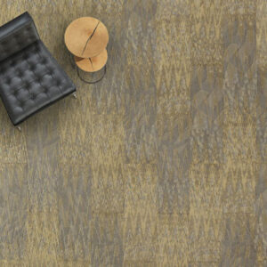 greenish carpet tile with black chair