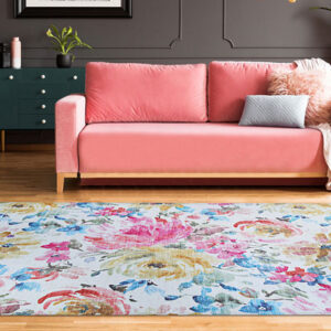floral area rug with pink couch