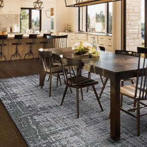 grey and dark grey area rug in dining room