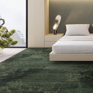 dark green rug with white bed
