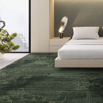 modern bedroom with dark green commercial carpet