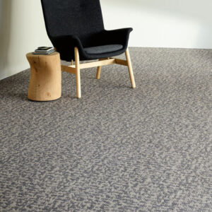 grey specked commercial carpet with black chair