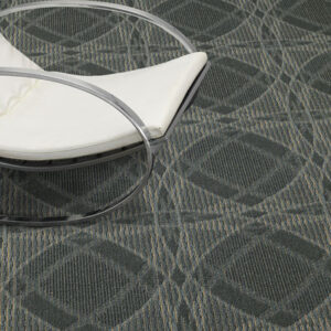 grey pattern commercial carpet with white chair