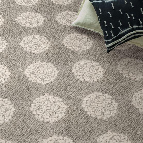 round pattern on grey carpet