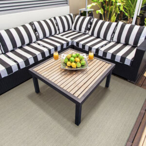 tan outdoor rug with stripped outdoor furniture