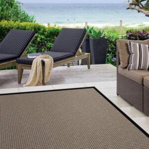 dark brown with dark trim outdoor rug with outdoor furniture