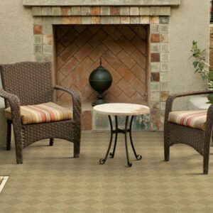 tan diamond pattern outdoor rug with outdoor furniture