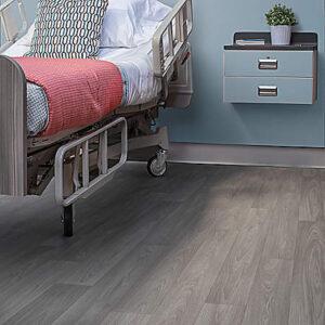warm grey resilient flooring in hospital room