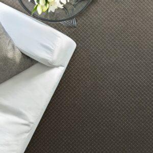 dark colored diamond pattern synthetic carpet
