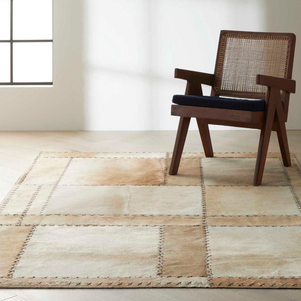 tan tones area rug in living room