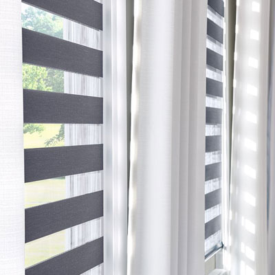 grey striped shade in window